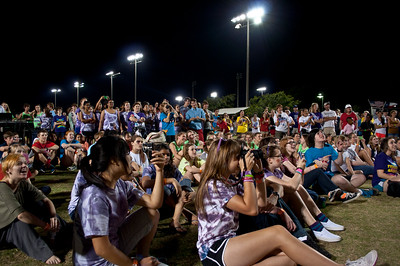everyone gathers around the stage for the Mr relay contest