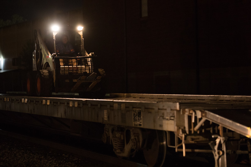 Joe Barker, an air brake technician, helps to load the circus flat cars prior to their departure from Charleston, WV.