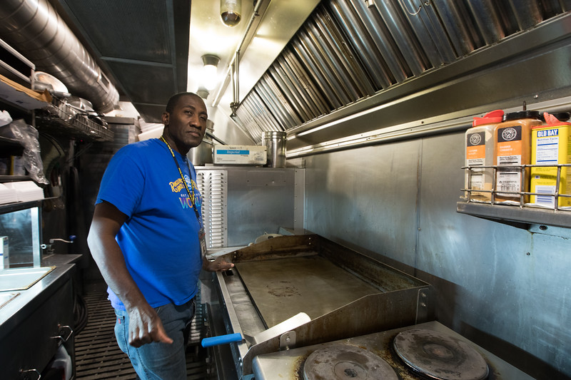 Tim Perkins, a cook on the Ringling Bros. and Barnum & Bailey Circus train, stands inside the Pie Car kitchen of the blue unit. The Pie Car, a traditional name for the circus train dining car, is a place where both performers and crew can grab a bite to eat or just enjoy some one on one time with friends.