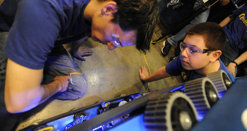 . Student mentor Shane Palmerino, left, and student Zac Couch of Hope Chapel Academy make adjustments at the First Robotics Competition, a Raytheon sponsored event where local high school students  built robots to compete, kicked off today at the Long Beach Arena in Long Beach, CA. on Wednesday March 19, 2014. (Photo by Sean Hiller/ Daily Breeze).