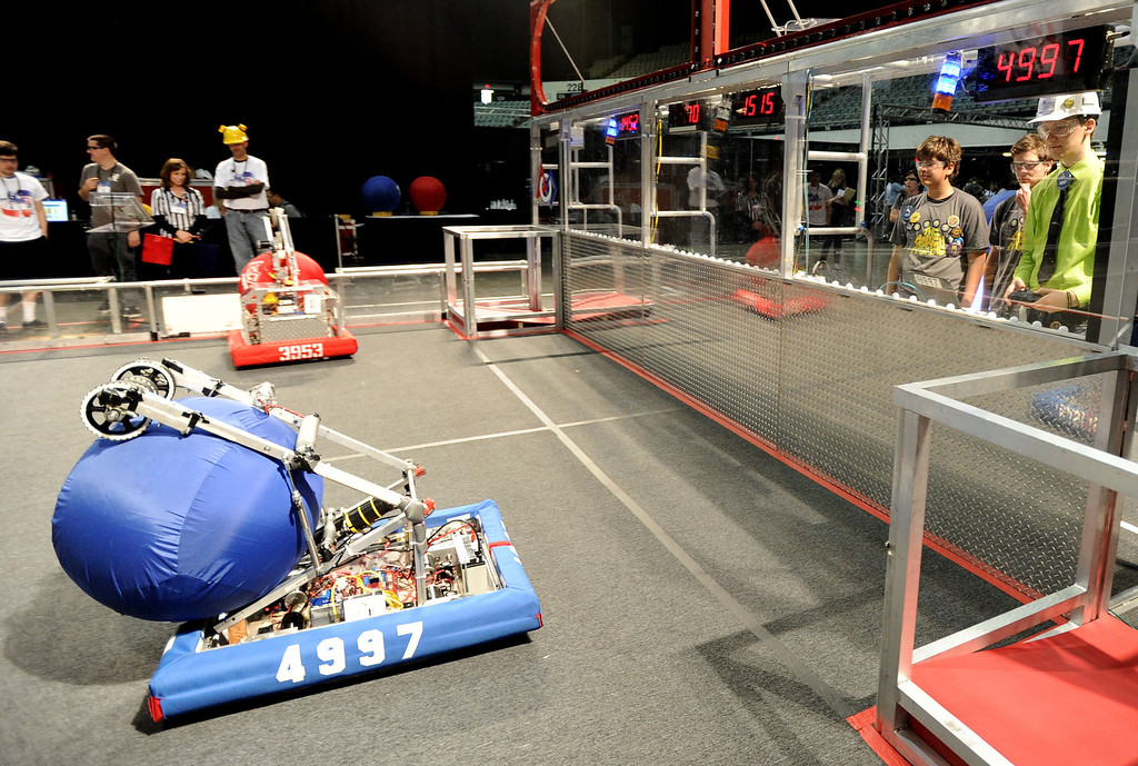 . Nathan Pannell, right, from Long Beach Poly operates the team\'s robot named Charlie during a test drive at the First Robotics Competition, a Raytheon sponsored event where local high school students  built robots to compete, kicked off today at the Long Beach Arena in Long Beach, CA. on Wednesday March 19, 2014. (Photo by Sean Hiller/ Daily Breeze).