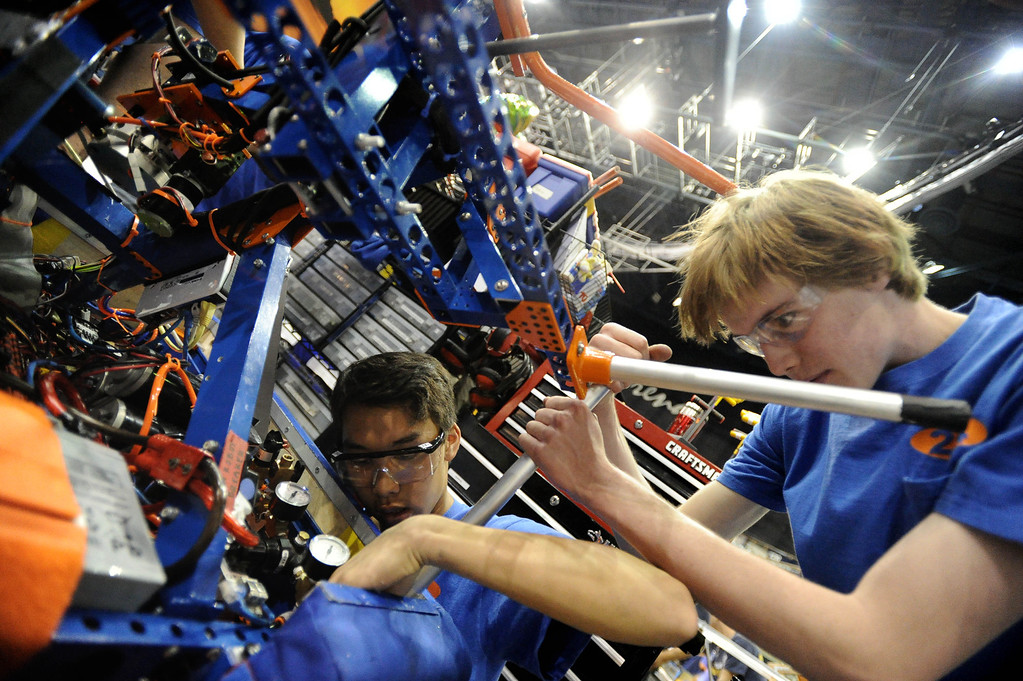 . Beach Cities Robotics members Matthew Chu of Redondo Union High, left, and Ryan Gulland of Mira Costa High make adjustments at the First Robotics Competition, a Raytheon sponsored event where local high school students  built robots to compete, kicked off today at the Long Beach Arena in Long Beach, CA. on Wednesday March 19, 2014. (Photo by Sean Hiller/ Daily Breeze).