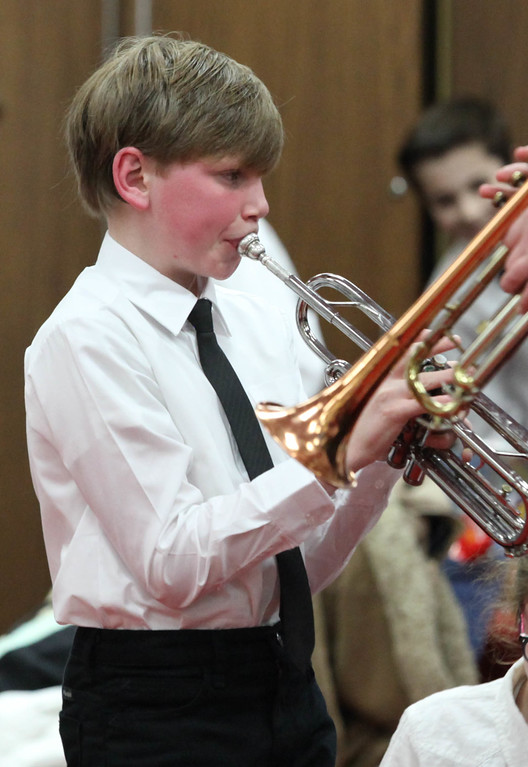 """Tibby McDowell   The Sheridan Press<br /> <br /> Kayden Roberts tunes his trumpet backstage for the Sheridan Junior High School """"Pops"""" Concert at Early Auditorium Thursday Feb. 8, 2018."""