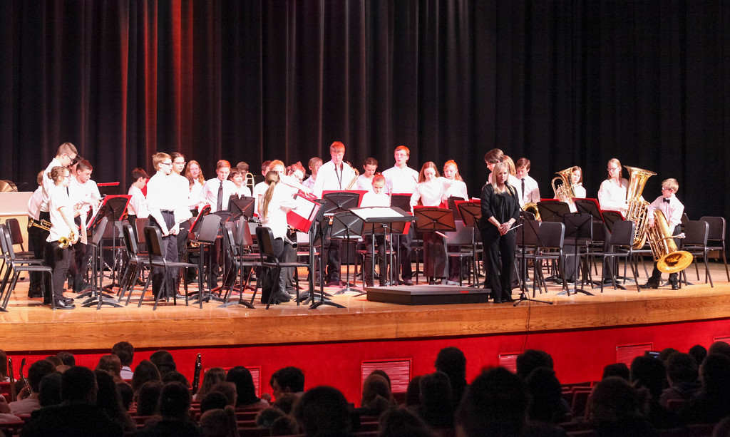 """Tibby McDowell   The Sheridan Press<br /> <br /> Band director Erin Knutson takes a bow with the beginning band students at the end of their performance during the Sheridan Junior High School """"Pops"""" Concert at Early Auditorium Thursday Feb. 8, 2018."""