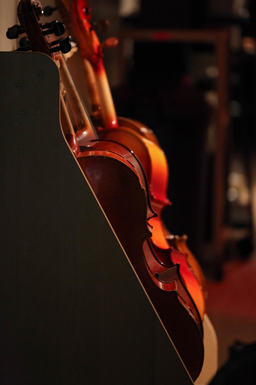 """Tibby McDowell   The Sheridan Press<br /> <br /> Cello's line the wall backstage of the Early Auditorium before the Sheridan Junior High School """"Pops"""" Concert Thursday Feb. 8, 2018."""