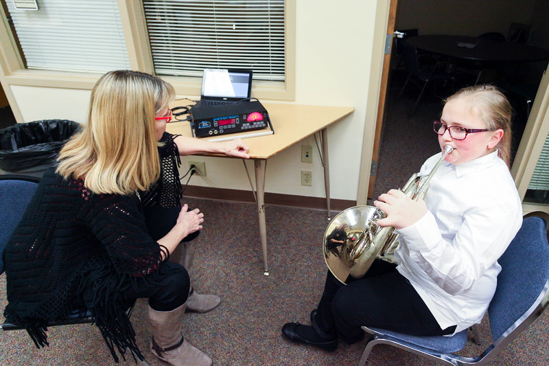"Tibby McDowell | The Sheridan Press<br /> <br /> Sheridan High School band director Diane Knutson, left, assists Loganne Martin tune her French horn before the Sheridan Junior High School ""Pops"" Concert at Early Auditorium Thursday Feb. 8, 2018."