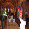 Acolytes process down the nave.