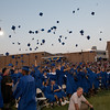 The Newburgh Free Academy (NFA) Class of 2012 toss their caps into the air at the conclusion of Commencement Exercises on Academy Field in the City of Newburgh, NY on Thursday, June 21, 2012. Hudson Valley Press/CHUCK STEWART, JR.