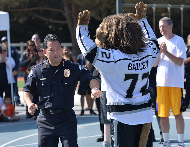 . Former Laker star Derek Fisher and Bailey, the mascot for Los Angeles Kings interact with kids at Camp Escapades held at Rolling Hills Country Day School Thursday August 18, 2016. Torrance Police Chief Mark Matsuda gives Bailey a playful jab.                    Photo by Robert Casillas / Daily Breeze