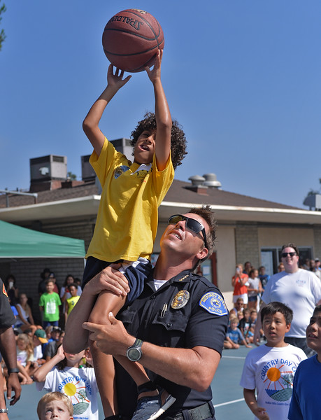 . Former Laker star Derek Fisher and Bailey, the mascot for Los Angeles Kings interact with kids at Camp Escapades held at Rolling Hills Country Day School Thursday August 18, 2016. Redondo Beach Police Chief Keith Kauffman helps a young boy make a basket during game.                     Photo by Robert Casillas / Daily Breeze