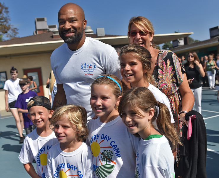 . Former Laker star Derek Fisher and Bailey, the mascot for Los Angeles Kings interact with kids at Camp Escapades held at Rolling Hills Country Day School Thursday August 18, 2016.                      Photo by Robert Casillas / Daily Breeze