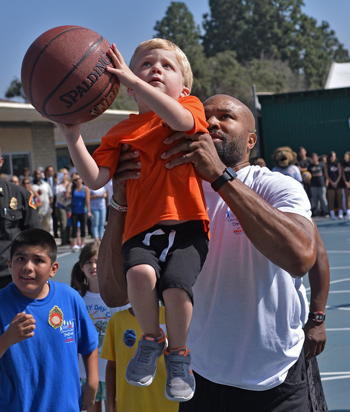 . Former Laker star Derek Fisher and Bailey, the mascot for Los Angeles Kings interact with kids at Camp Escapades held at Rolling Hills Country Day School Thursday August 18, 2016. Fisher lifts Charlie Pope, 4, so he can make a basket.                    Photo by Robert Casillas / Daily Breeze
