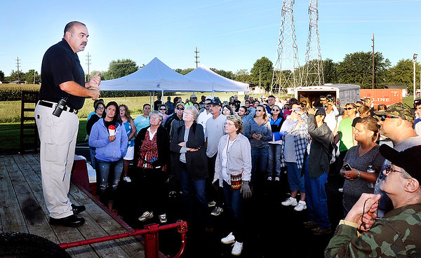 John P. Cleary   The Herald Bulletin<br /> New Castle Assistant Police Chief Mark Stacy gives instructions to the more then 150 volunteers that showed up Monday morning to help with a ground search for missing person Larry Tucker.