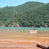 The lake water is pretty clear, but the boat wakes churns up the red dirt causing this brown appearance. We kept the ski anchored to it wouldn't be hitting the rock bottom.