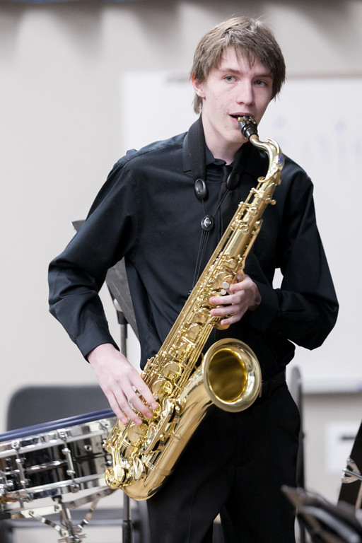 Tibby McDowell | The Sheridan Press<br /> Landon Alsup warms up his tenor saxophone backstage prior to performing in the Jazz program at the Whitney Center for the Arts at Sheridan College Thursday, March 8, 2018.