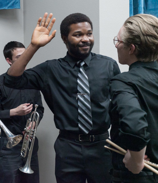 Tibby McDowell | The Sheridan Press<br /> Ebenezer Eferobot gives a high five to drummer Andrew Weitz prior to taking the stage for the Jazz program at the Whitney Center for the Arts at Sheridan College Thursday, March 8, 2018.