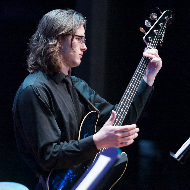 Tibby McDowell | The Sheridan Press<br /> Christian Schultze plays the electric bass during the Jazztet portion of the Jazz program at the Whitney Center for the Arts at Sheridan College Thursday, March 8, 2018.