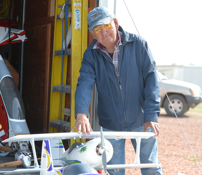 Ryan Patterson | The Sheridan Press<br /> Dale Abell of Billings stands next to a plane during the Sheridan Flying Cowboys R/C Club annual fly-in Sunday, Sept. 9, 2018. Forty-seven people participated in the multi-day event.