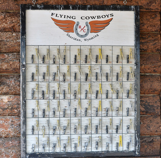Ryan Patterson | The Sheridan Press<br /> A sign hangs during the Sheridan Flying Cowboys R/C Club annual fly-in Sunday, Sept. 9, 2018. Forty-seven people participated in the multi-day event.