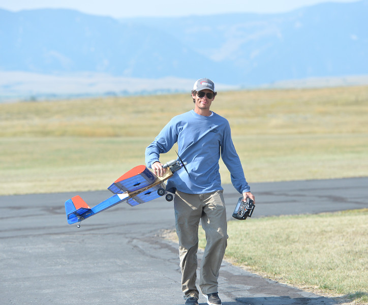 Ryan Patterson | The Sheridan Press<br /> Conlin Parrott carries his plane during the Sheridan Flying Cowboys R/C Club annual fly-in Sunday, Sept. 9, 2018. Forty-seven people participated in the multi-day event.