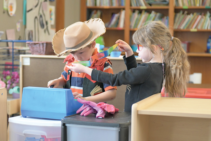 Matthew Gaston | The Sheridan Press<br>Rycker Wight plays with a toy cash register while Autum Clark tries to put glasses on him at Head Start Tuesday, April 9, 2019.