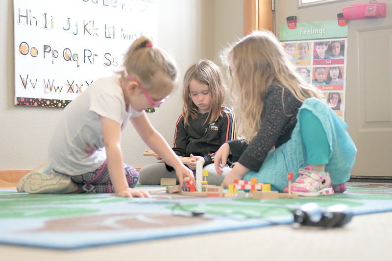 "Matthew Gaston | The Sheridan Press<br>During ""work time"" at Head Start, from left, Fable Trueblood, Isabell Schwarzbach and September Knox play with blocks, wooden track and trains Tuesday, April 9, 2019."