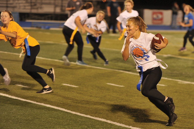 Matthew Gaston | The Sheridan Press<br>Freshman Aubrey Cooper finds a hole in the defense at Sheridan High Schools Powderpuff game Tuesday, Oct. 2, 2018.