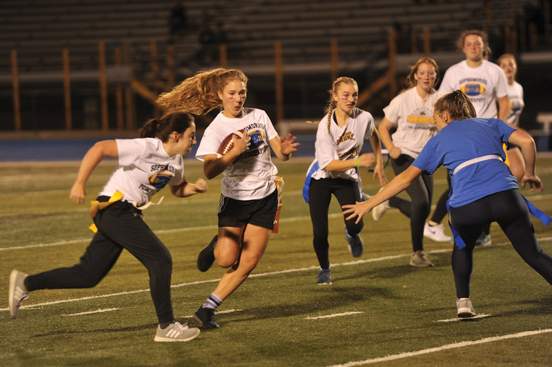 Matthew Gaston | The Sheridan Press<br>Aria Heyneman, a sophomore at Sheridan High School finds some room to run during the Powderpuff game Tuesday, Oct. 2, 2018.