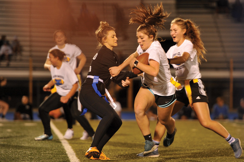 "Matthew Gaston | The Sheridan Press<br>Sophmore Addy Bolton breaks a ""tackle,"" during the Powderpuff game Tuesday, Oct. 2, 2018 at Sheridan High School."