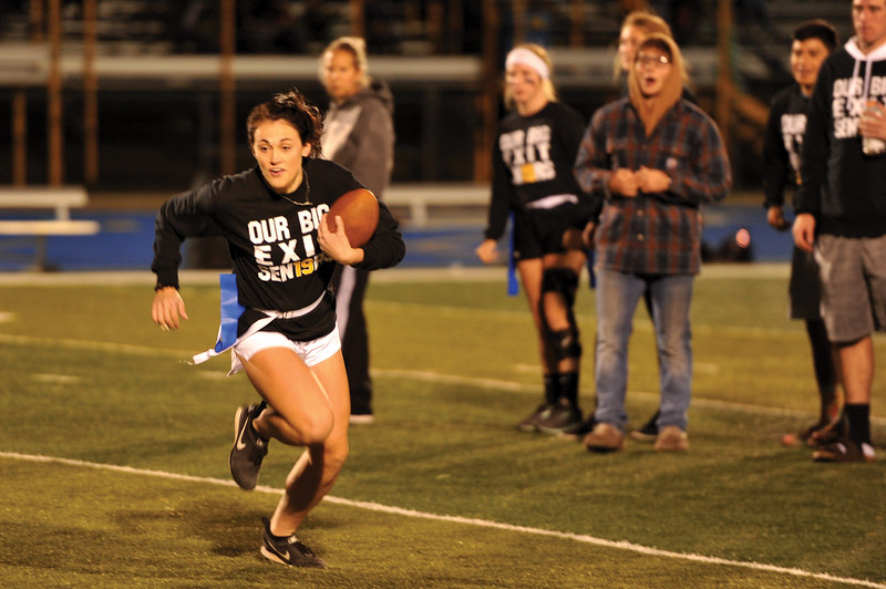 Matthew Gaston | The Sheridan Press<br>Madison Godwin makes a break for the sideline to gain eight yards for the Seniors during the Sheridan High School Powderpuff game Tuesday, Oct. 2, 2018.