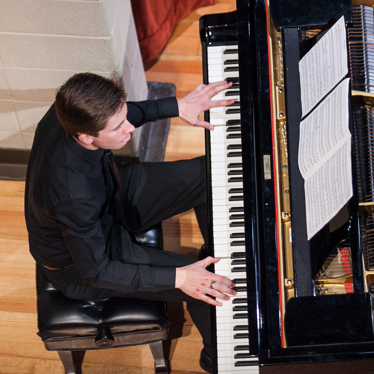 Tibby McDowell | The Sheridan Press  All-State band member Hunter Andersen plays the piano for Wind Ensemble during the Sheridan High School Festival Concert at Sue Henry Theater Tuesday, April 10, 2018.