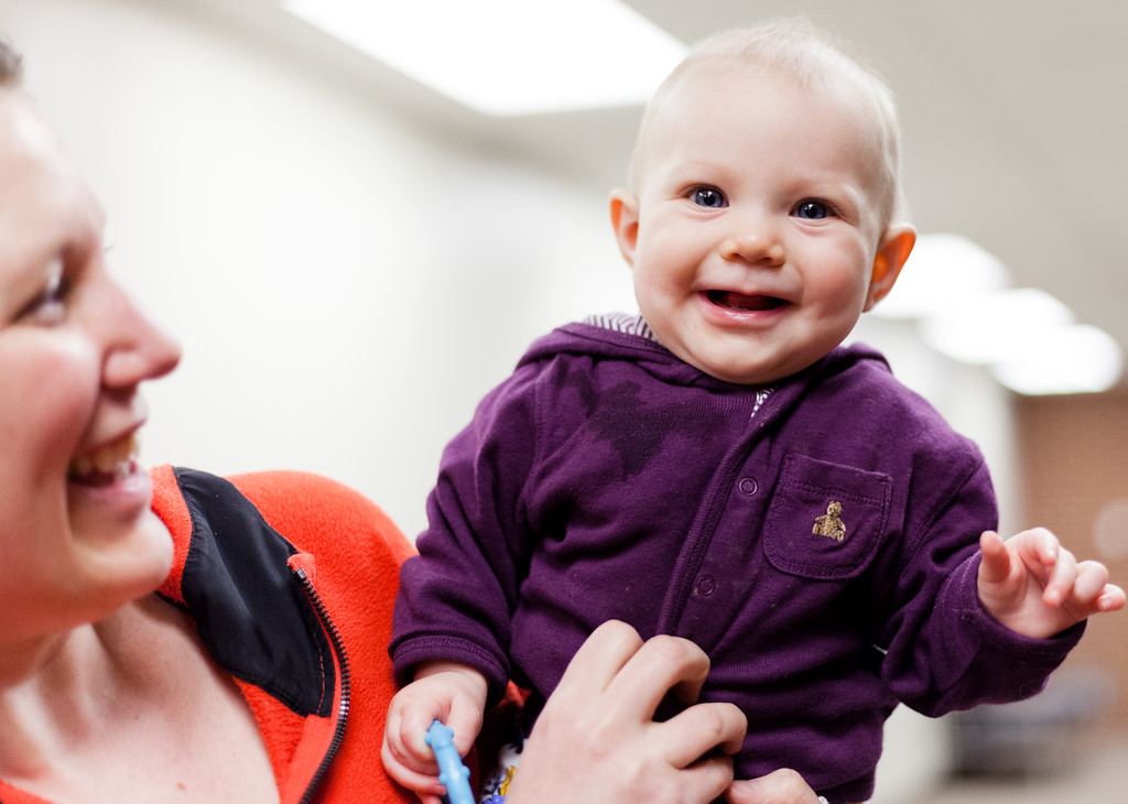 Tibby McDowell | The Sheridan Press<br /> Suzy Gonda, left, kept five and a half month old Cecily entertained in the lobby during the orchestra concert at the Sheridan Junior High School Early Auditorium Wednesday, March 21, 2018.