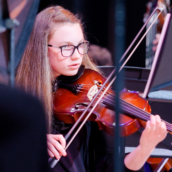 Tibby McDowell | The Sheridan Press<br /> Isabele Cleland plays with the orchestra during the concert at the Sheridan Junior High School Early Auditorium Wednesday, March 21, 2018.