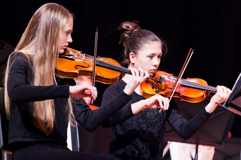 Tibby McDowell | The Sheridan Press<br /> Dulce Carroll, left, and Gingi Gonzalez play their violins during the orchestra concert at the Sheridan Junior High School Early Auditorium Wednesday, March 21, 2018.