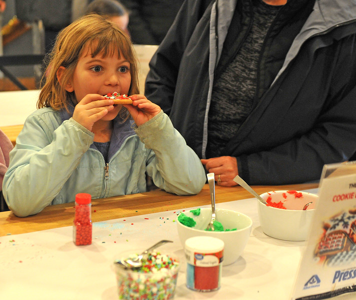 Ryan Patterson | The Sheridan Press<br /> Megan Varah eats a cookie during a cookie decorating party hosted by The Sheridan Press at Cottonwood Kitchen + Home Friday, Nov. 23, 2018.