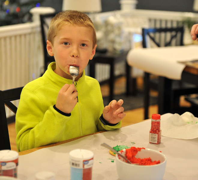 Ryan Patterson | The Sheridan Press<br /> Logan Miller licks a spoon during a cookie decorating party hosted by The Sheridan Press at Cottonwood Kitchen + Home Friday, Nov. 23, 2018.