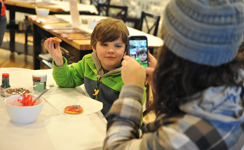 Ryan Patterson | The Sheridan Press<br /> Caroline Houck, right, takes a photo of her son Oliver Houck during a cookie decorating party hosted by The Sheridan Press at Cottonwood Kitchen + Home Friday, Nov. 23, 2018.