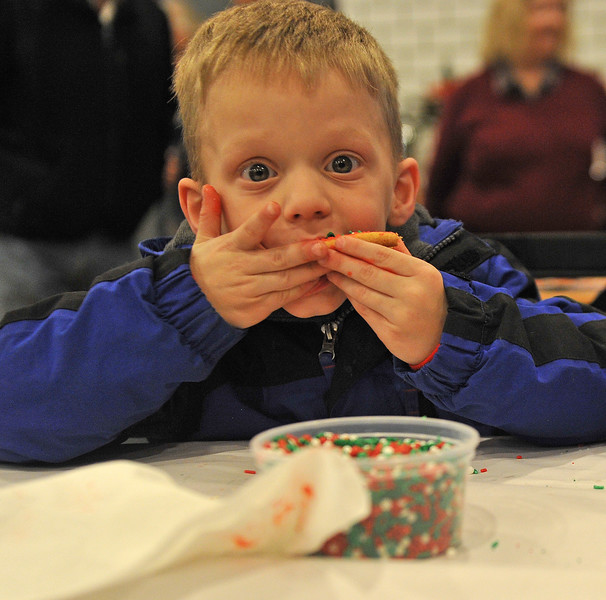 Ryan Patterson | The Sheridan Press<br /> Gregory Darr eats a cookie during a cookie decorating party hosted by The Sheridan Press at Cottonwood Kitchen + Home Friday, Nov. 23, 2018.