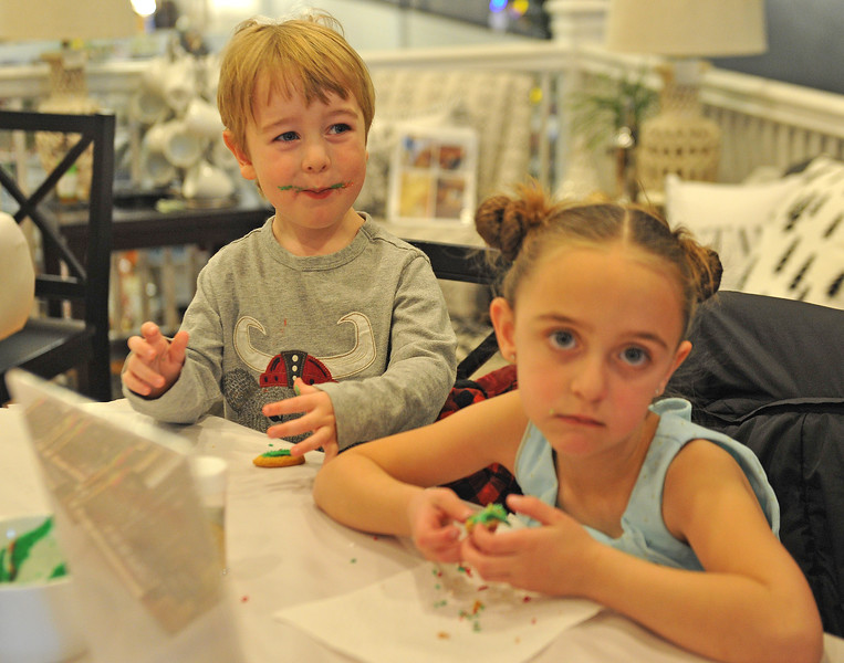 Ryan Patterson | The Sheridan Press<br /> Teddy Broersma, left, and Alice Broersma participate in a cookie decorating party hosted by The Sheridan Press at Cottonwood Kitchen + Home Friday, Nov. 23, 2018.