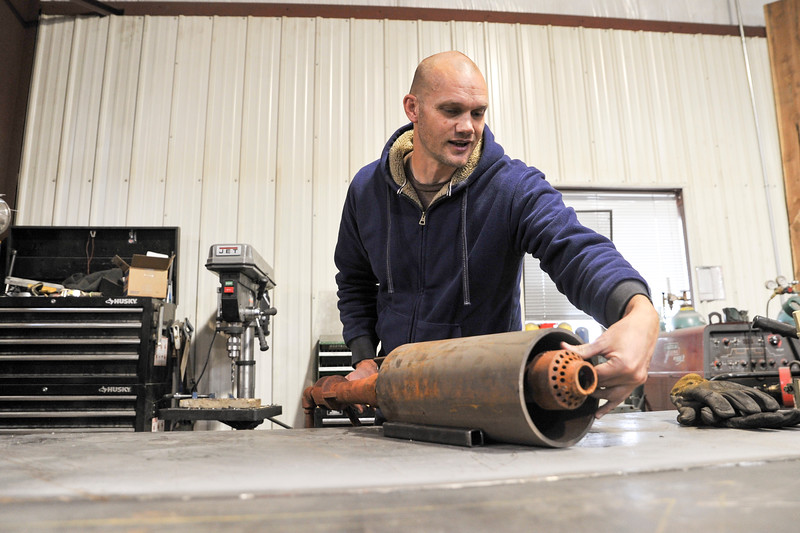 Ashleigh Fox | The Sheridan Press<br>Chad Reckard works on a small piece of his equipment for a prototype, ThermMaker, Tuesday, Nov. 6, 2018. Reckard will present the automatied fluid heater to a panel of judges for the Start-Up Challenge Pitch Night Thursday.