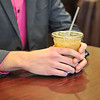 Ashleigh Fox | The Sheridan Press<br>Aaron Baker enjoys an iced amaretto latte at Java Moon Wednesday, Nov. 7, 2018. Baker will present his business plan for My-Town Thursday in front of a panel of judges for the Sheridan Start-Up Challenge Pitch Night.