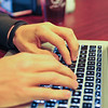 Ashleigh Fox | The Sheridan Press<br>Spencer Kuzara works on his laptop at Java Moon Wednesday, Nov. 7, 2018. Kuzara works as a programmer and is developing a program that processes digital currency.