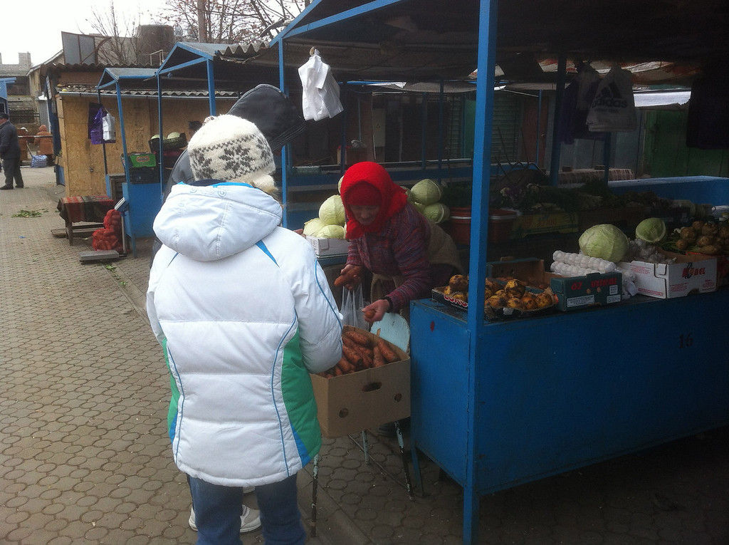 Ashley with her first experience buying things at the market.