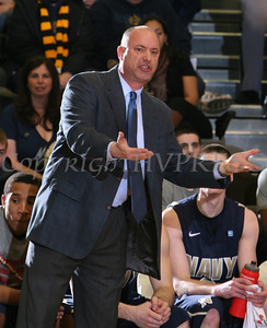 Navy head coach Ed DeChellis gives instructions to players during their Patriot League game at the United States Military Academy's Christl Arena in West Point, NY on Saturday, February 11, 2012. Army defeated Navy 69-63 in double overtime. Hudson Valley Press/CHUCK STEWART, JR.