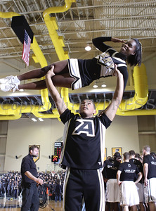The Army Black Knight Rabble Rousers entertain the crowd during a time out during the annual Army-Navy Patriot League game at the United States Military Academy's Christl Arena in West Point, NY on Saturday, February 11, 2012. Army defeated Navy 69-63 in double overtime. Hudson Valley Press/CHUCK STEWART, JR.