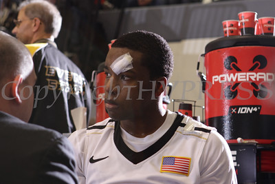 Army Black Knight guard Maxwell Lenox (0) is treated for a cut over his left eye during their Patriot League game against Navy at the United States Military Academy's Christl Arena in West Point, NY on Saturday, February 11, 2012. Army defeated Navy 69-63 in double overtime. Hudson Valley Press/CHUCK STEWART, JR.