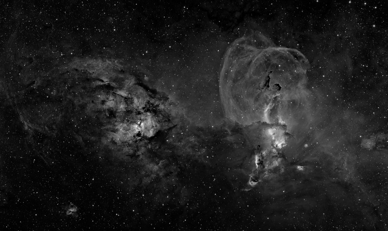 RCW 57 in Carina. The left and right halves are completey different in character. The left half, surrounding open cluster NGC 3603, is chaotic, with much black dust yet to be converted into stars. The right half, including NGC 3581 and many others, shows great billowing arcs of material, presumably subsequent to supernova explosions, and is presumably older.<br /> <br /> H-alpha 19 hrs in 1 hr subs. Aspen CG16M on 20 inch PlaneWave. Three panel mosaic. Processed with our own GoodLook 64