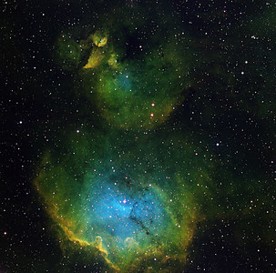 """The Chick. Just NW of lambda Centauri. The bottom half of the image (Gum 39)  is arguably an oyster-shell shaped bird bath, partially filled with blue water in the bottom. The top half (IC 2872) is a newborn chick, with two bulbous eyes, and a rather sharp beak, complete with egg-tooth. This region is much fainter than the region closer to Lambda, and harder to image. The shock front at about 8 o'clock from the water is impressive..  Green: H-alpha 7hr, Blue: OIII 9 hr, Red: SII 8hr, all in 1hr subs. Aspen CG16M on 20"""" PlaneWave."""