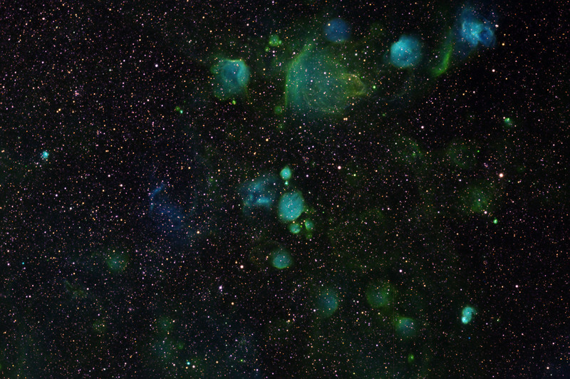 Region around NGC 249-261-267 in lesser Magellanic Cloud. Very strong separation between H-alpha (3 hours, green) and OIII (3 hours, blue). Virtually no SII detectable (3 hours, red). I am minded of a box of chocolates wrapped in brightly coloured foil.