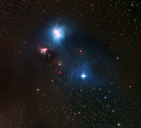 "Corona Australis dust complex with multiple Herbig-Haro objects. At 9 o'clock from centre, Master Yoda, emerging under blue mist, is wearing a black, shapeless cloak. His reddened gnarled and arthriic left hand holds a yellow walking stick, in reality a light sabre sporting twin Herbig Haro jets studded with multiple bright red Herbig-Haro objects. There are at least 12 identifiable HH's in the image. Note the complete absence of stars from the thickest boomerang  band of dust, the brilliatn reflection nebulosity, and a face-on spiral (unexpected amongst the clutter) toward right of the bottom edge.  H-alpha (mapped to red) a whopping 19hrs. Lum 4.5hrs. RGB 3hrs each.  Aspen CG16M on 20"" PlaneWave on MI-750 fork."